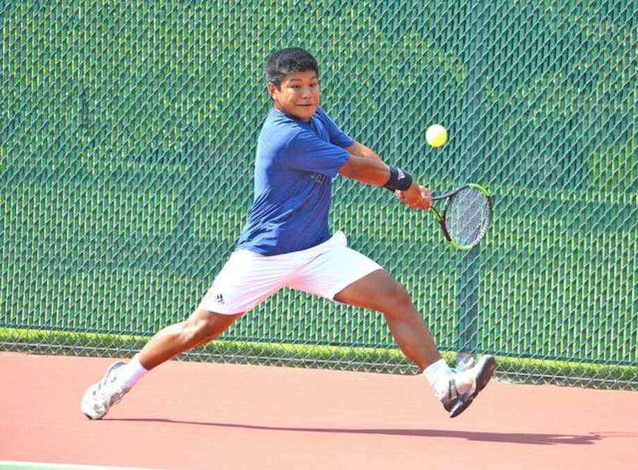 Zach Trimpe, a 2019 Edwardsville High School graduate, hits a two-handed backhand during his 17th-place quarterfinal in last year's Pro Wildcard Challenge at the EHS Tennis Center
