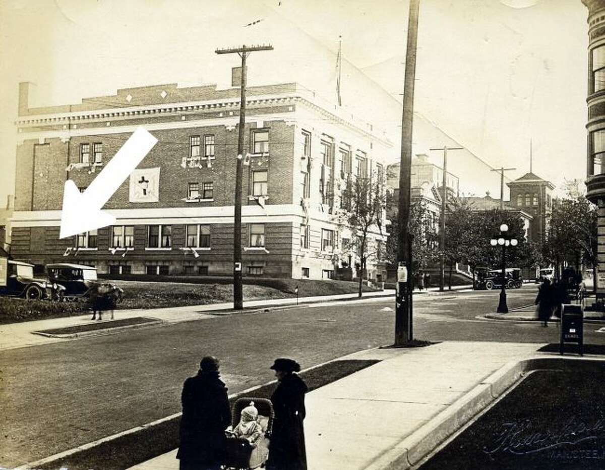 This arrow points to the current location of the Manistee News Advocate and shows what that area looked like in the 1920s.