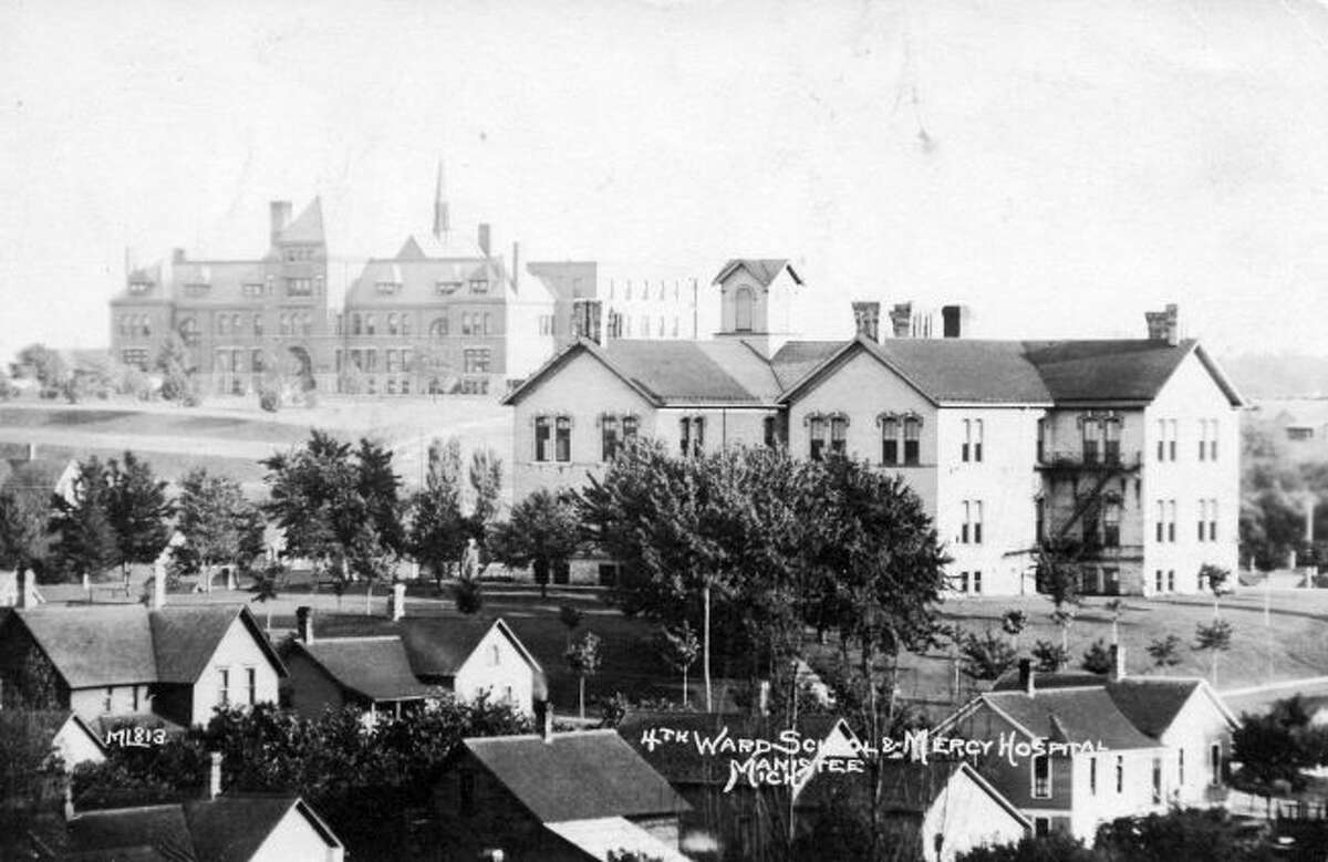 The Fourth Ward School building in the above photo was originally constructed in 1882 on the southeast corner of Ramsdell and Ninth Street. Over the next 15 years that building was expanded and added on to. In the background of the photo stands the former Mercy Hospital.