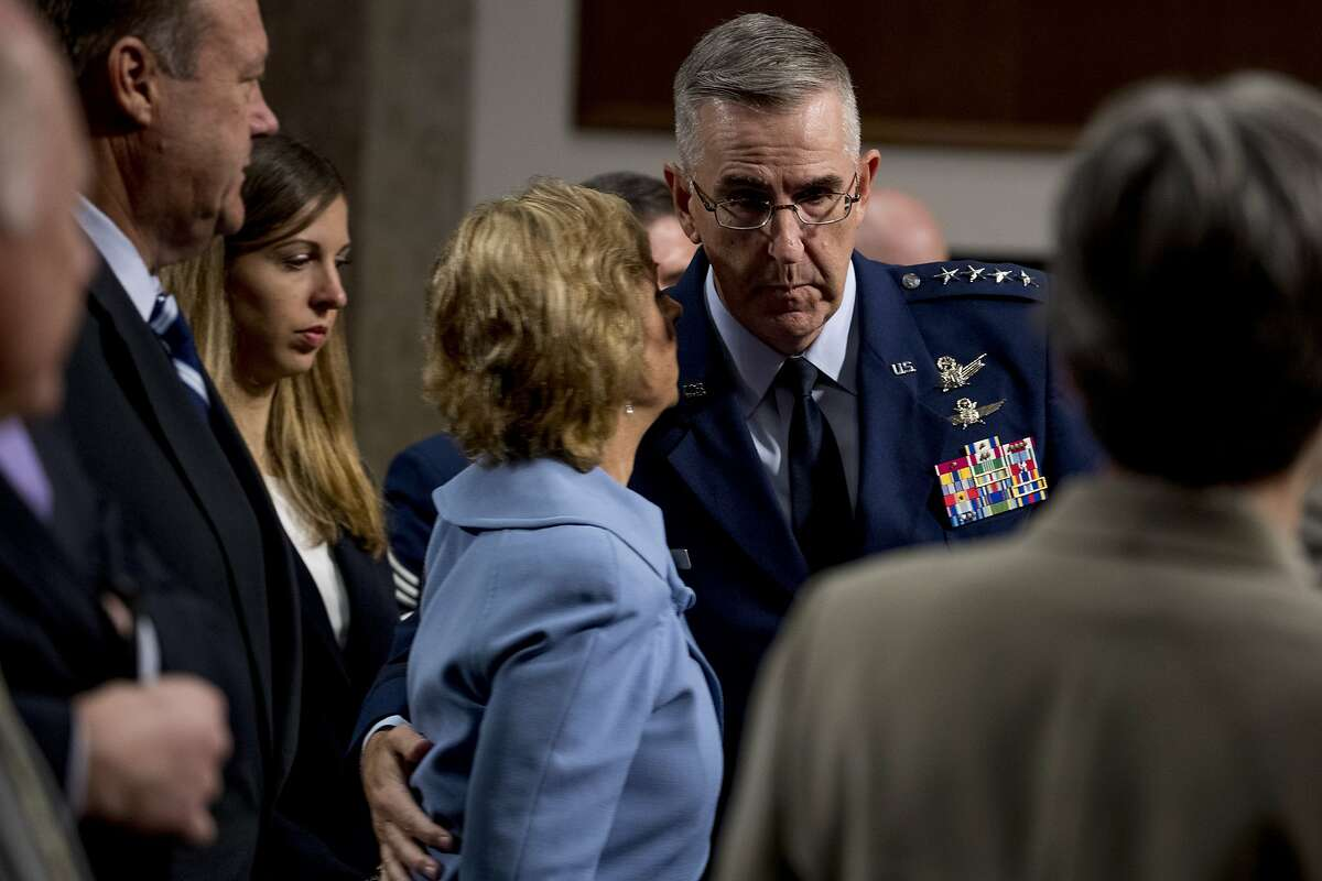 Gen. John Hyten, right, hugs his wife Laura, following a Senate Armed Services Committee hearing on Capitol Hill in Washington, Tuesday, July 30, 2019, for his confirmation hearing to be Vice Chairman of the Joint Chiefs of Staff. Hyten's former aide, Army Col. Kathryn Spletstoser, alleges he subjected her to a series of unwanted sexual advances. (AP Photo/Andrew Harnik)