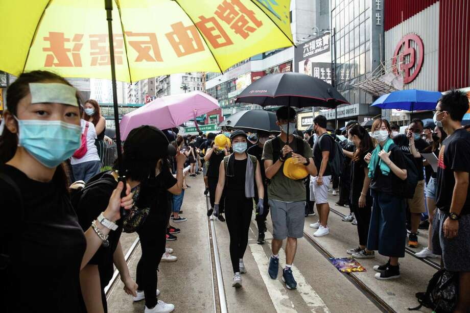 Demonstrators gather during a protest in the Causeway Bay district of Hong Kong, China, on Sunday, July 28, 2019. Hong Kong police and protesters faced off for the eighth straight weekend as the China-backed government struggles to quell discontent over Beijing's increasing control over the financial hub. Photographer: Justin Chin/Bloomberg Photo: KYLE LAM / Bloomberg / © 2019 Bloomberg Finance LP