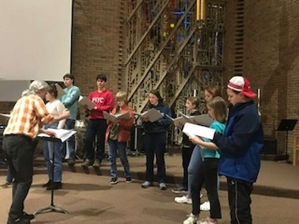 Manistee Youth Chorus director Joy Smith leads the chorus in a practice session to prepare for their concert at 2 p.m. on Nov. 17 at the Ramsdell Theatre.