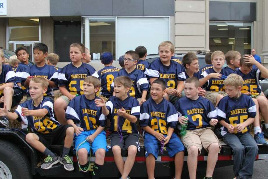 This group of future Chippewa football players enjoy the homecoming parade.