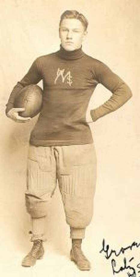 Football equipment was different in 1908 as indicated by this picture of a Manistee High School player.