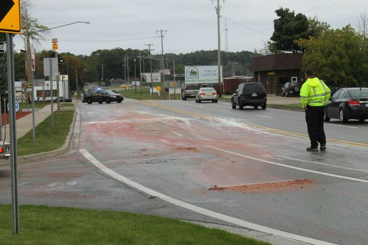 From about 3-4:30 p.m. Friday, a paint spill closed part of U.S. 31 in Manistee after a truck carrying paint cans turned the corner and tipped over. The paint was quickly cleaned up by the City of Manistee Fire Department. (Sean Bradley/News Advocate)