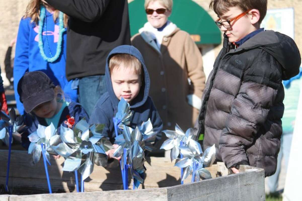 """Shown is a scene from the 2015 """"Take a Spin for Children"""" walk that will be taking place this year from 5-7 p.m. in Manistee to help in the fight against child abuse and neglect."""