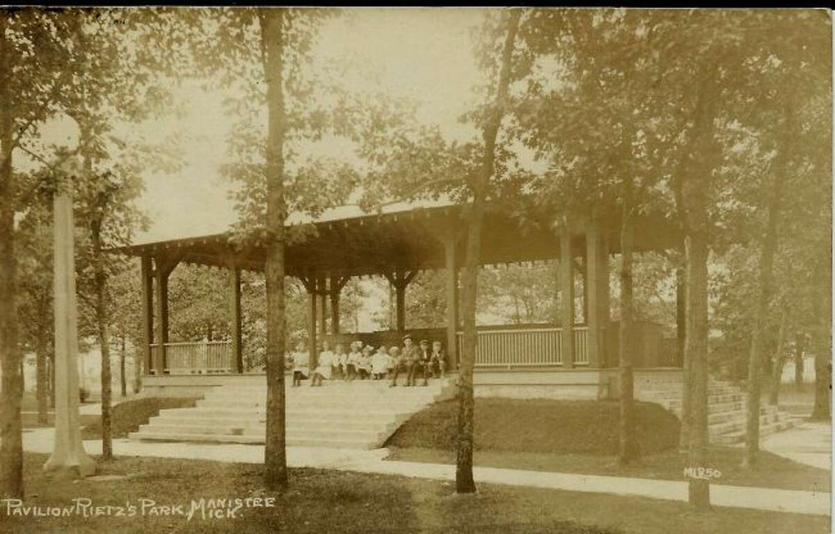 The Pavilion at Reitz Park is shown being used by many children in this early 1900 photograph.