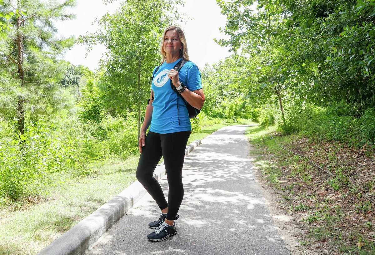 Laura Conely, founder of Urban Paths, is a nutritionist and life coach, who works one-on-one with clients, while they walk on trails throughout Houston.