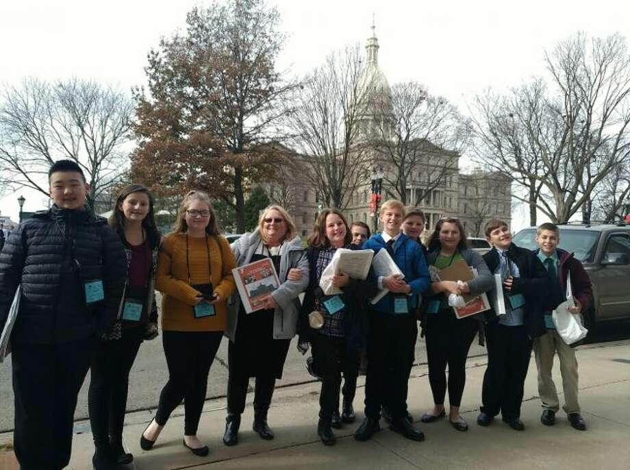 Members of the Manistee Middle School Youth in Government group are shown in front of the state capitol building in Lansing during their recent conference.