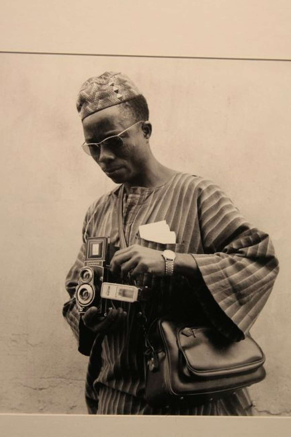 This self portrait shows the late Tijani Sitou who made many classic portraits during the 1970s and 80s in Mali. Thirty one of his portraits are on display at West Shore Community College.