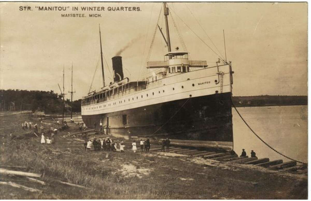 The steamer Manitou prepares to take on a load of passengers from this docking area on Manistee Lake in the 1890s.