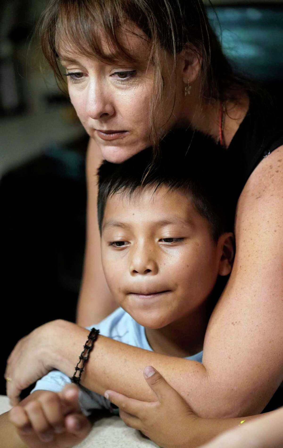 Holly Sewell gives Byron Xol, an immigrant from Guatemala, a hug during his birthday party, June 23, in Buda. Byron was separated from his father, David Xol-Cholom, in May 2018. The government is using loopholes to continue separating immigrant children from their families.