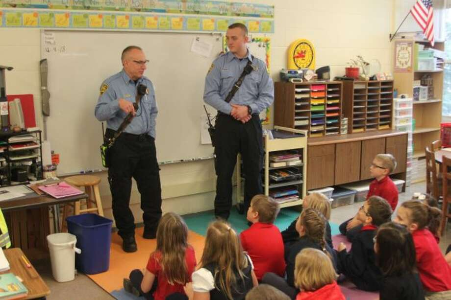 City of Manistee firefighters Doug Dominick and Dan Reck talk to the third grade class at Manistee Catholic Central about fire safety. Students in the kindergarten to sixth grade level get two visits a year by the local fire department to teach the students about how to be safe from fire at home.
