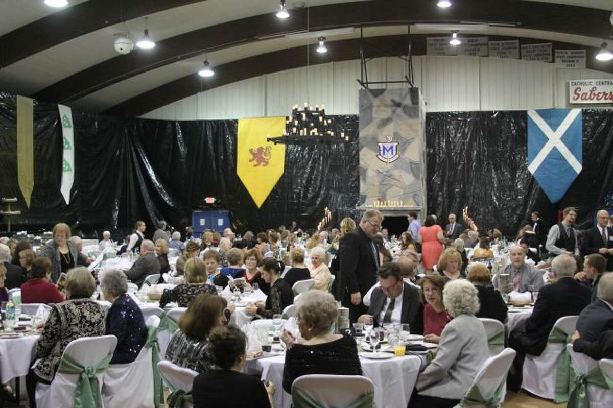 """The Manistee Catholic Central gymnasium was transformed into a beautiful ballroom like setting with a Scottish flavor to it for the HARVEST Fling's """"A Night in the Celtic Highlands."""