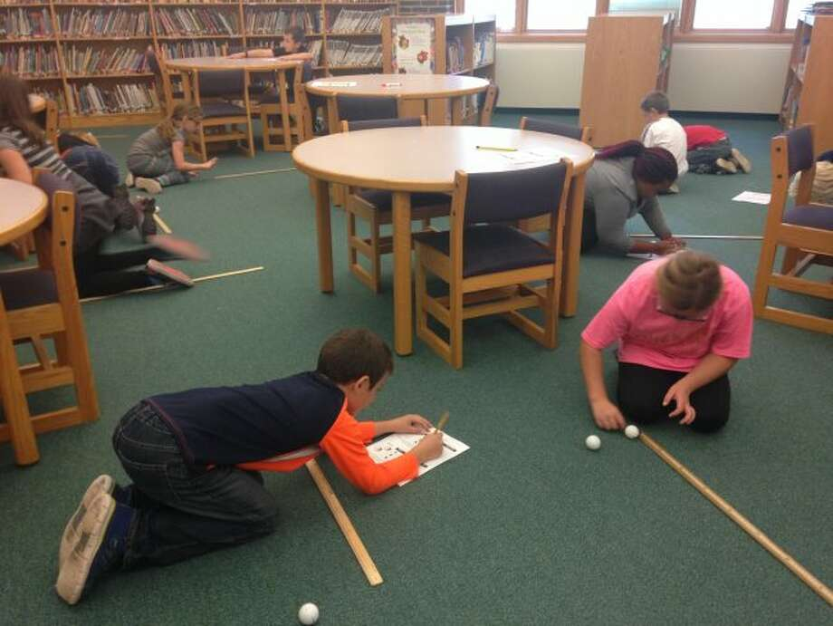 The Onekama School Media Center became an elementary science lab last week, as third grade students tested Newton's Second Law of Motion.