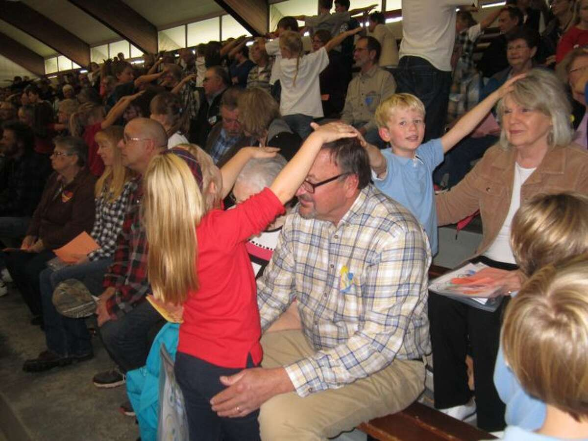 Elementary students at Manistee Catholic Central and their grandparents celebrated a special Grandparents Day. One of the many things the students did that day was to give a blessing to their grandparents.
