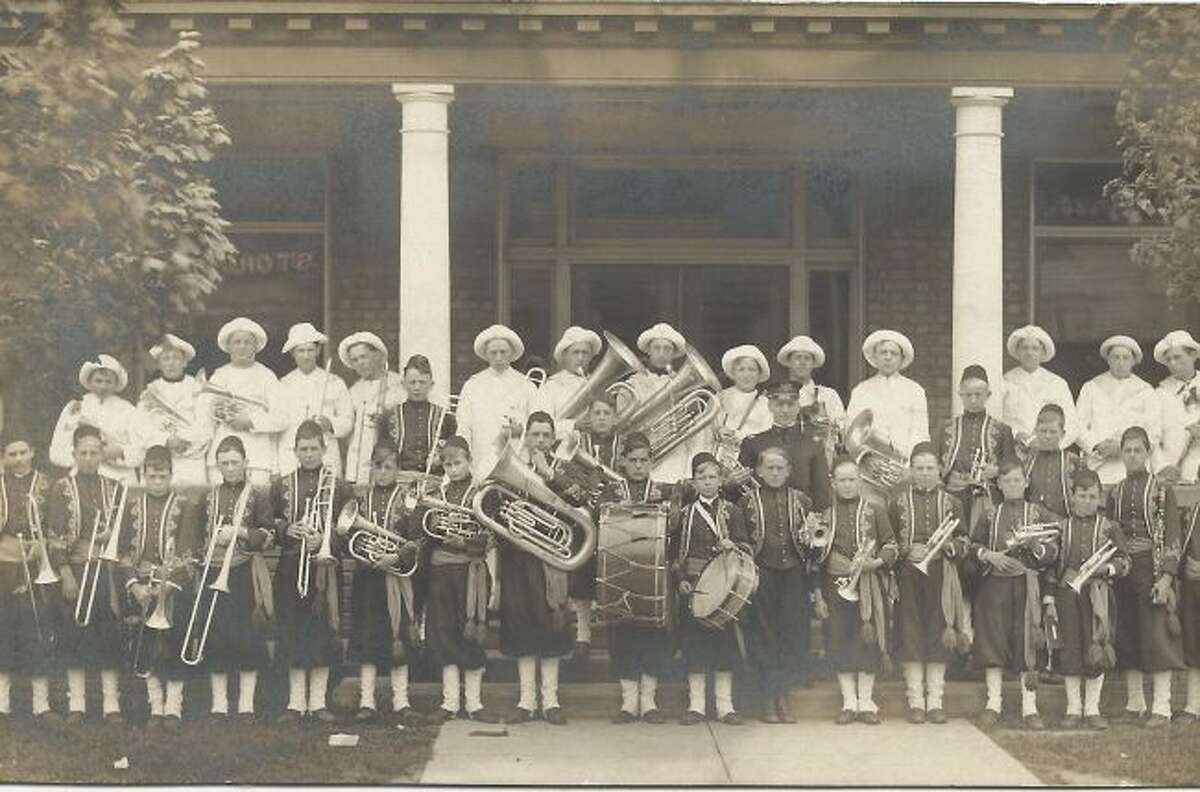 One of the many bands that provided entertainment in the Manistee area in the early 1900s was the Zuave Band who are pictured in front of the Briny Building.