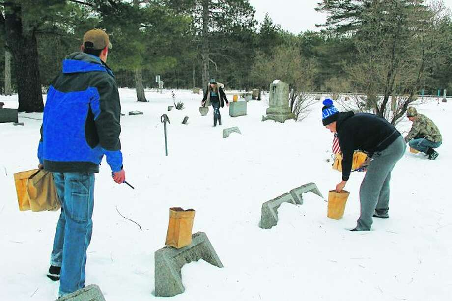 Kaleva's Maple Grove Township Cemetery lights up the night each year on Dec. 21 during the Kaleva Historical Society's annual winter solstice event. (News Advocate File Photo)