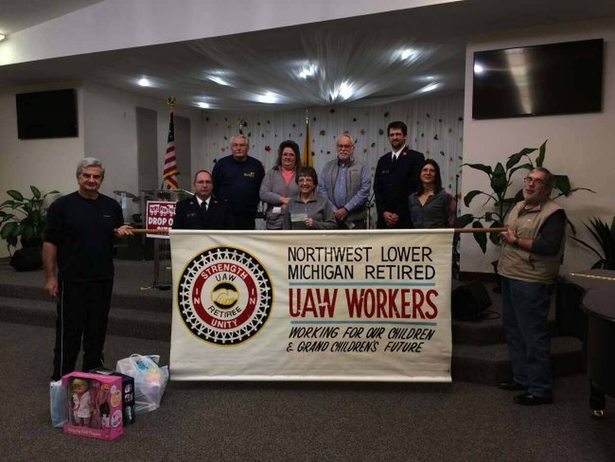 On Nov. 8, the UAW Retirees, of the Northern Lower Michigan chapter, Traverse City, presented donations to food pantries in six adjacent counties. The Matthew 25:35 Food Pantry, Manistee, was presented with a check for $1,000. Representatives from the food pantry appreciate the donation. (Courtesy photo)