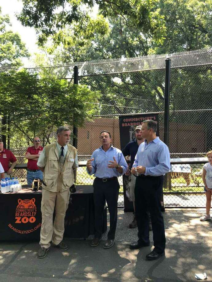 Connecticut's Beardsley Zoo Director Gregg Dancho, Mayor Joe Ganim and Kochiss family representative Ken Kochiss announced Monday that the zoo had received more than $3 million to expand the Amur tiger habitat. Photo: Daphne Saloomey / Hearst Connecticut Media