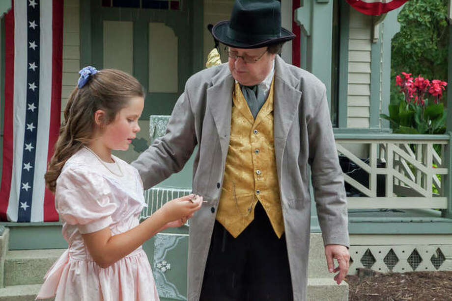 Grace Harner (left) and Kerry Miller (right) portray Lucy Haskell and Dr. William Haskell at the 17th Annual Lucy Haskell Birthday Party Monday in Alton. Photo: Jeanie Stephens | The Telegraph