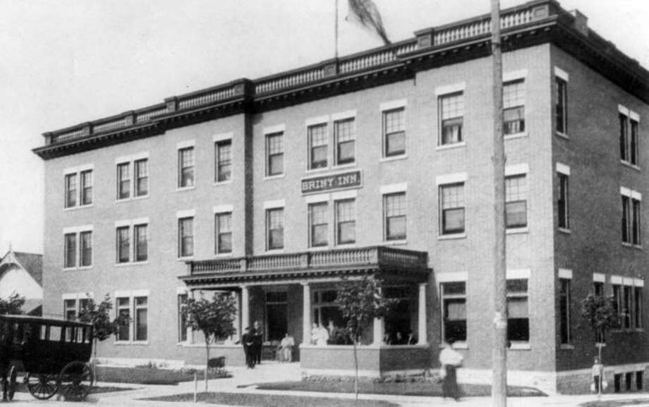 By 1910, the Manistee Salt & Mineral Bath Company was remodeled into the Briny Inn, a first class hotel. The building was destroyed by fire in 1917 but was rebuilt in 1918 by the Cooper Underwear Factory.