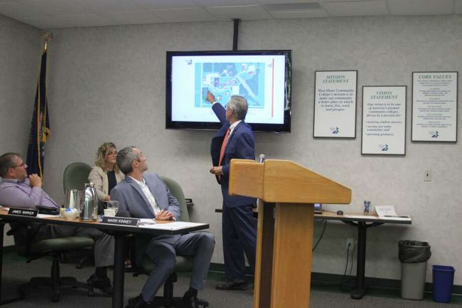 Architect Tom Mathison of Mathison Architects points to a diagram as he gives members of the West Shore Community College Board of Trustees a report on the Facilities Master Plan Update.