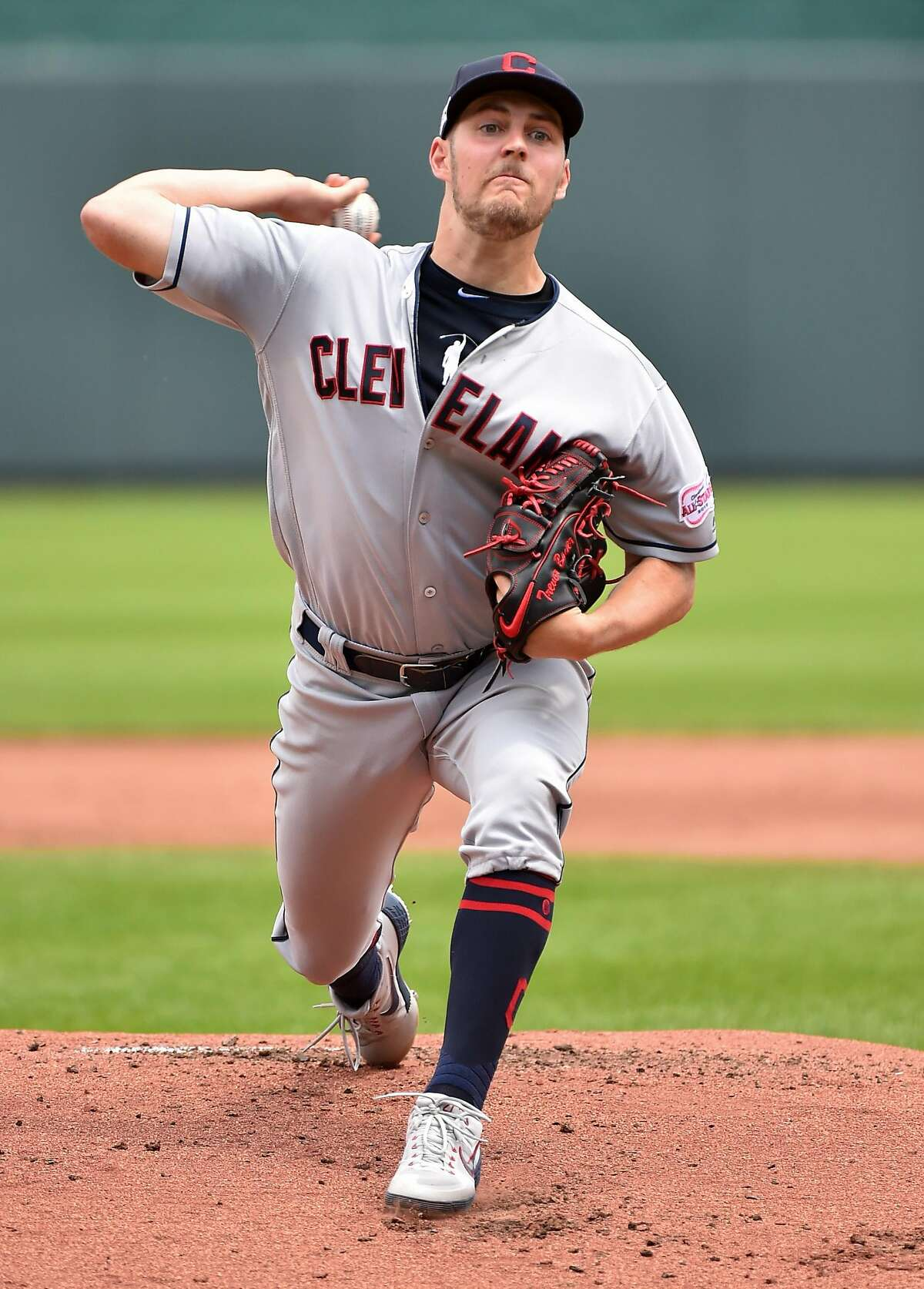 Starting pitcher Trevor Bauer #47 of the Cleveland Indians throws in the first inning against Kansas City Royals at Kauffman Stadium on July 28, 2019 in Kansas City, Missouri. (Photo by Ed Zurga/Getty Images)