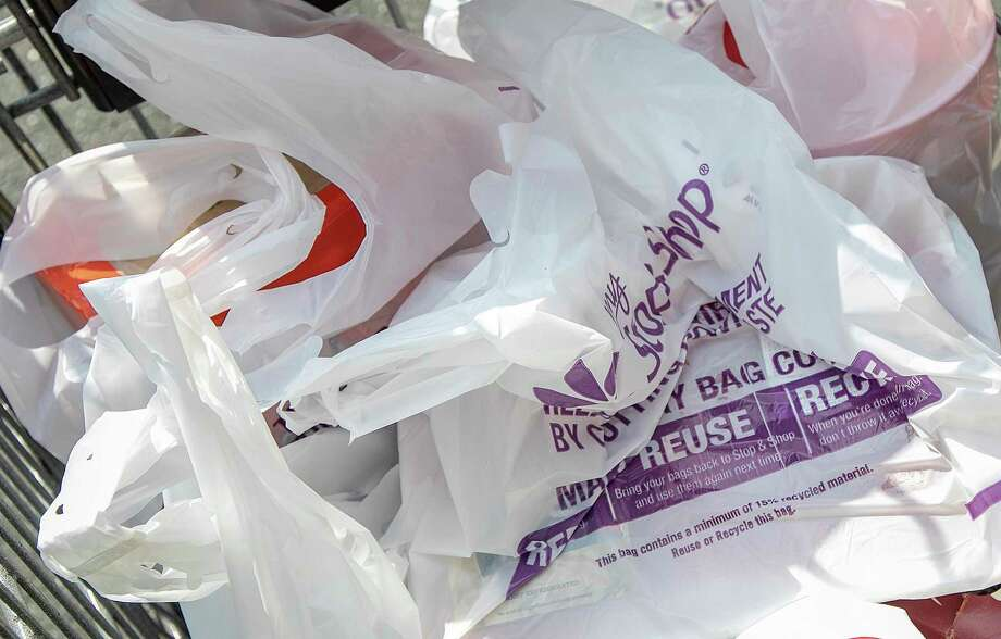 This photo shows plastic bags at Stop & Shop in Wallingford, Conn. The grocery store chain says it is eliminating single-use plastic bags at checkout at its Connecticut stores. (Dave Zajac/Record-Journal via AP) Photo: DAVE ZAJAC / Associated Press / Dave Zajac