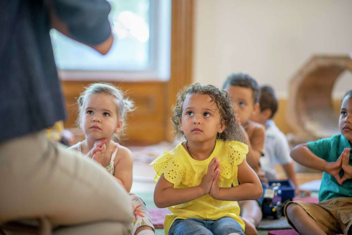 Children are learning mindfulness techniques in school.