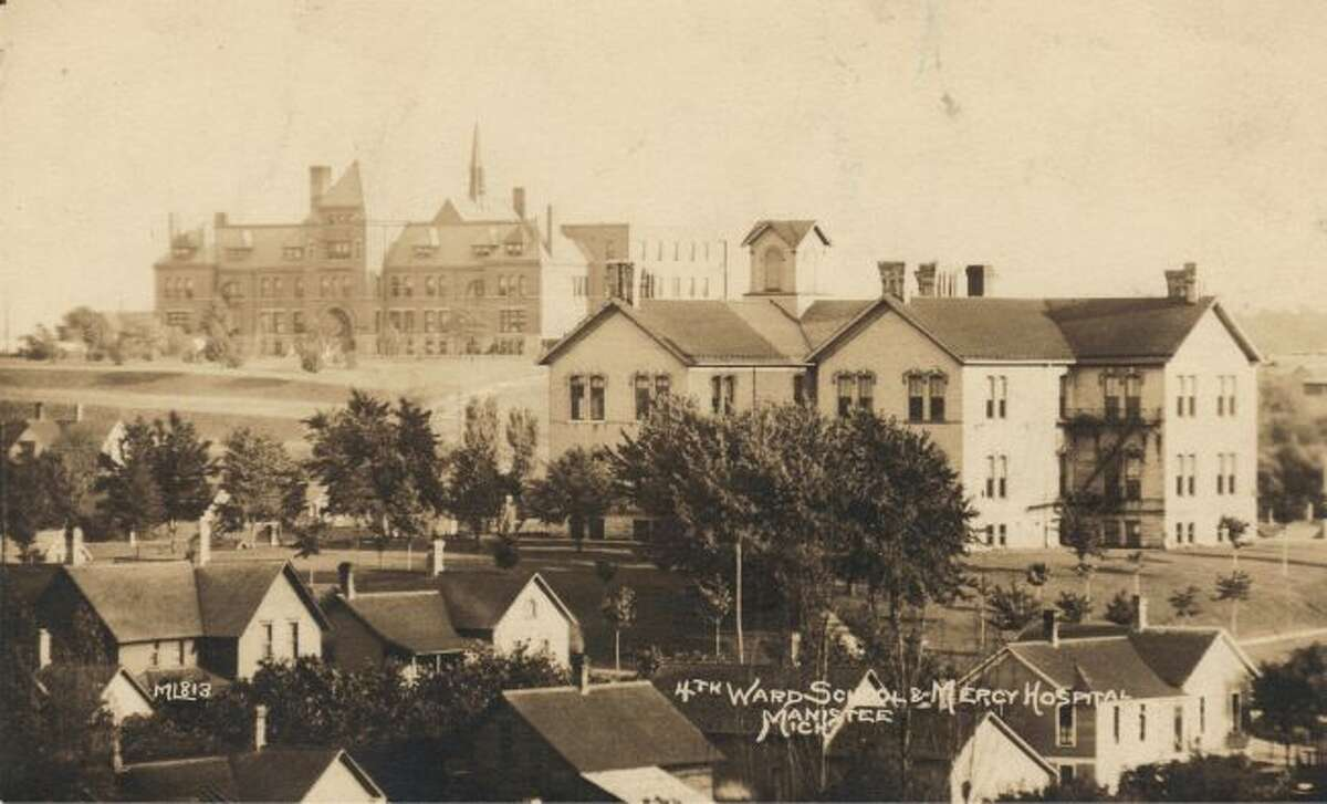Manistee's Fourth Ward is shown in this early 1900s picture with Mercy Hospital in the background.