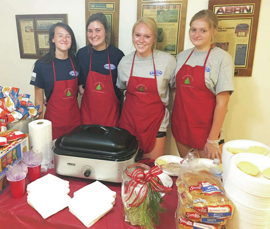 Christmas in July servers left to right, Katelyn Shaw, Paige Heinemeier, Christmas In July co-sponsor Taylor Freer, and her cousin Emily King, all of whom attend Alton High School. Taylor's sister, Lily, not pictured, is also a co-sponsor. Photo: Jill Moon|The Telegraph