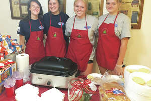 Christmas in July servers left to right, Katelyn Shaw, Paige Heinemeier, Christmas In July co-sponsor Taylor Freer, and her cousin Emily King, all of whom attend Alton High School. Taylor's sister, Lily, not pictured, is also a co-sponsor.