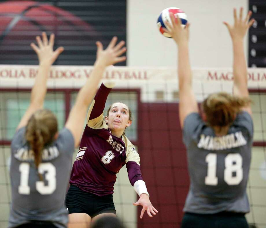Magnolia West's Alyssa May (8) hits between Magnolia's Lily Dalton (13) and Brynn Botkin (18)during their match at Magnolia High School, Tuesday, Oct. 2, 2018 in Magnolia, TX. Photo: Michael Wyke, Houston Chronicle / Contributor / © 2018 Houston Chronicle