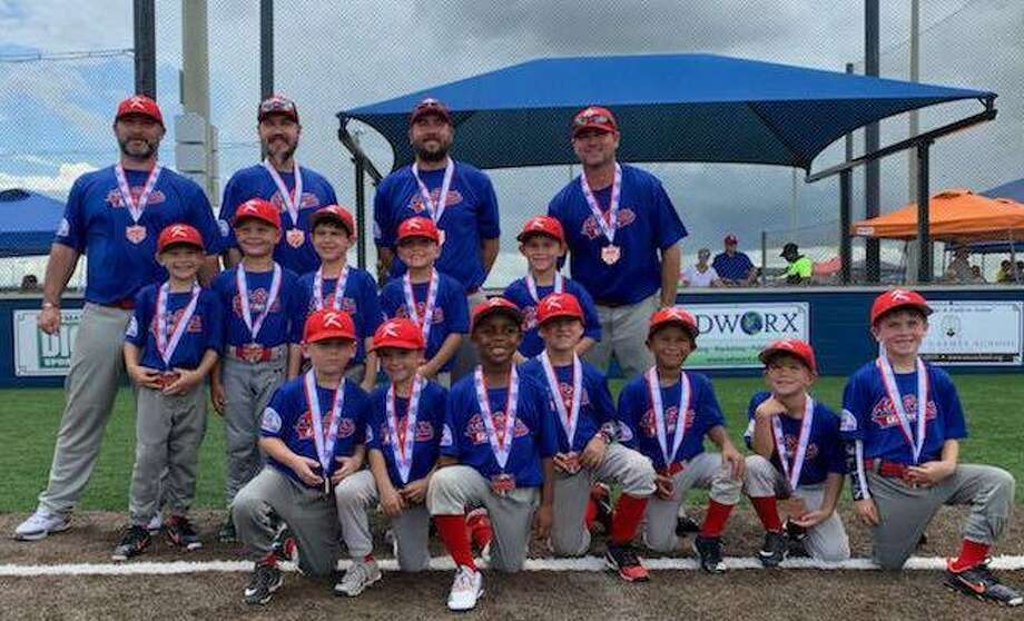 The Katy Pony All-Stars came home with third-place medals after competing in a field of 20 teams at the T-Ball Pony World Series in Youngsville, La, July 24-27. Coaches of the 6-six-year-olds are, from left, top row: Jason McDonald, Dan Miller, Clint Reeves and Brandon Surface. The players, from left, standing are: Graham Miller, Cooper Hess, Gustavo Peralta, Liam Ballew and Jace Surface; bottom row: Dax McDonald, Blake Pregler, Riley Hill, Rhett Bell, Adrian Hoyos, Blake Clark and Riley Reeves. Photo: Amanda Miller / Amanda Miller