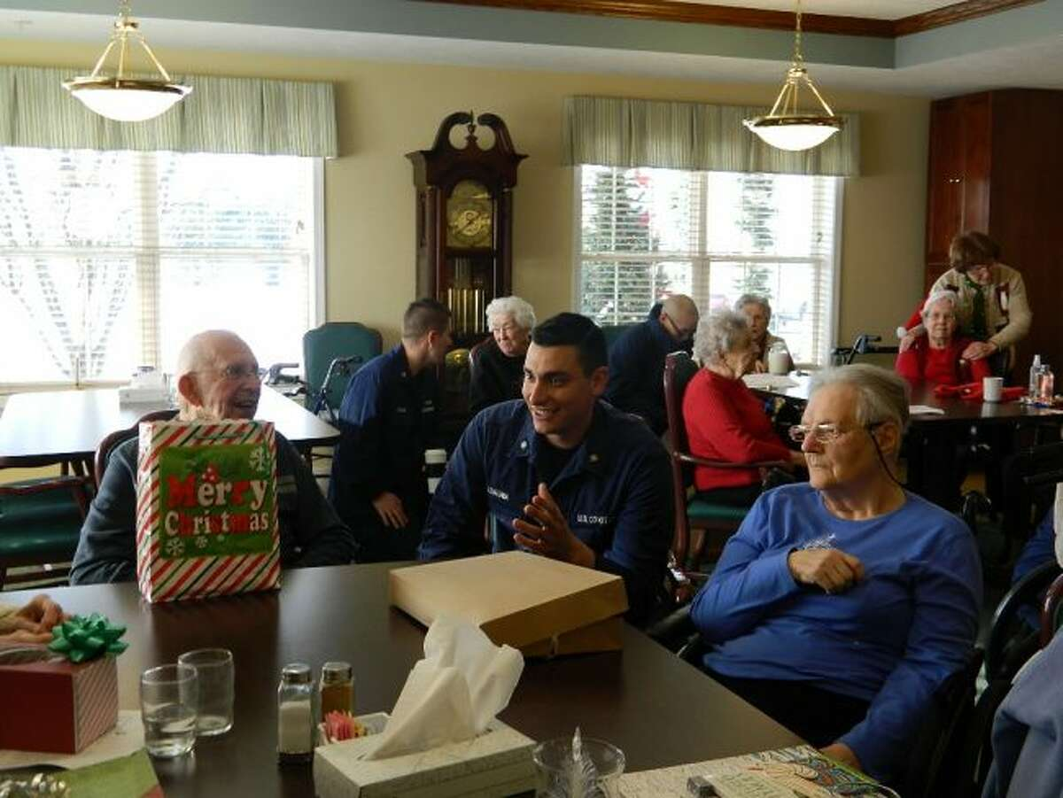 Members of Coast Guard Station Manistee took time during the holiday season to visit the residents of Green Acres Retirement Living. It was an opportunity for residents to visit with the Coast Guard members and express their appreciation for all they do.