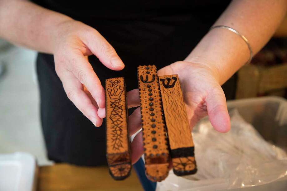 Chava Gal-Or holds mezuzahs made out of wood by her son Aryeh Grossman who is a wood artisan. Gal-Or sends them to Jewish families who lost theirs during natural disasters. Friday, June 21, 2019, in Houston. Photo: Marie D. De Jesús, Houston Chronicle / Staff Photographer / © 2019 Houston Chronicle