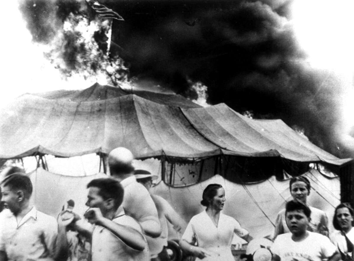 Circus spectators run for safety as a fire beaks out in a tent, July 6, 1944, at the Ringling Bros. Barnum and Bailey Circus, in Hartford. By the time the tent collapsed, 167 people were dead and more than 700 injured in the disaster that became known as