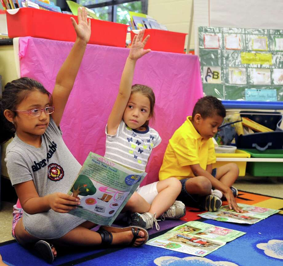 Students raise their hands during summer school classes at Stillmeadow Elementary School on Tuesday, July 10, 2012. Photo: Lindsay Niegelberg / Lindsay Niegelberg / Stamford Advocate