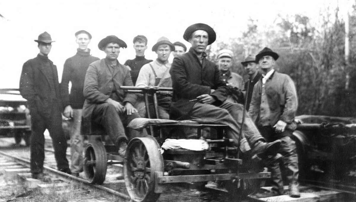 A fishing party on a railroad handcar takes the Manistee & Luther Railroad to reach their destination.