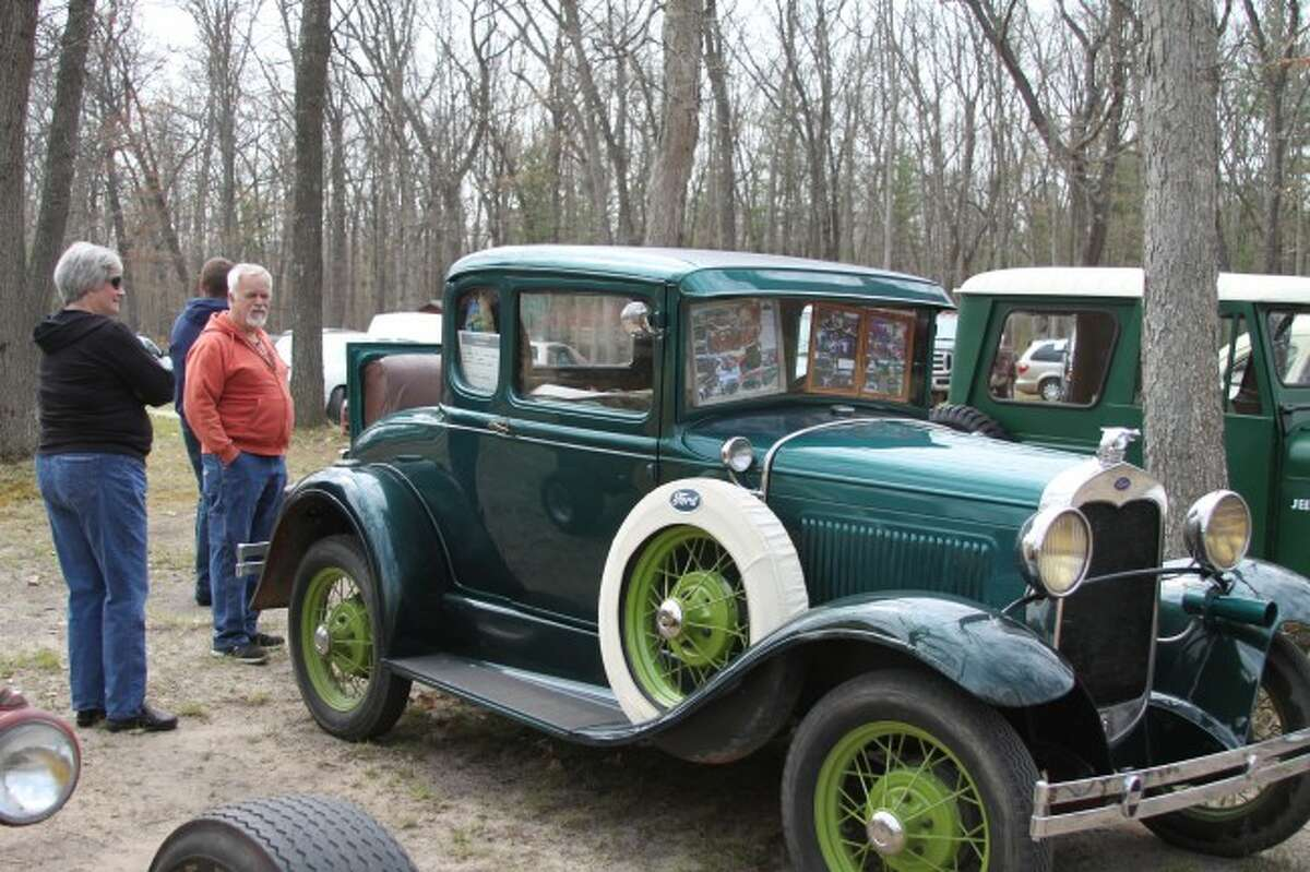 The fifth annual Rats and Rods Car Party drew all kinds of vehicles to the Muzzleloaders Club on Saturday including classic ones like this early model Ford that was admired by many people.