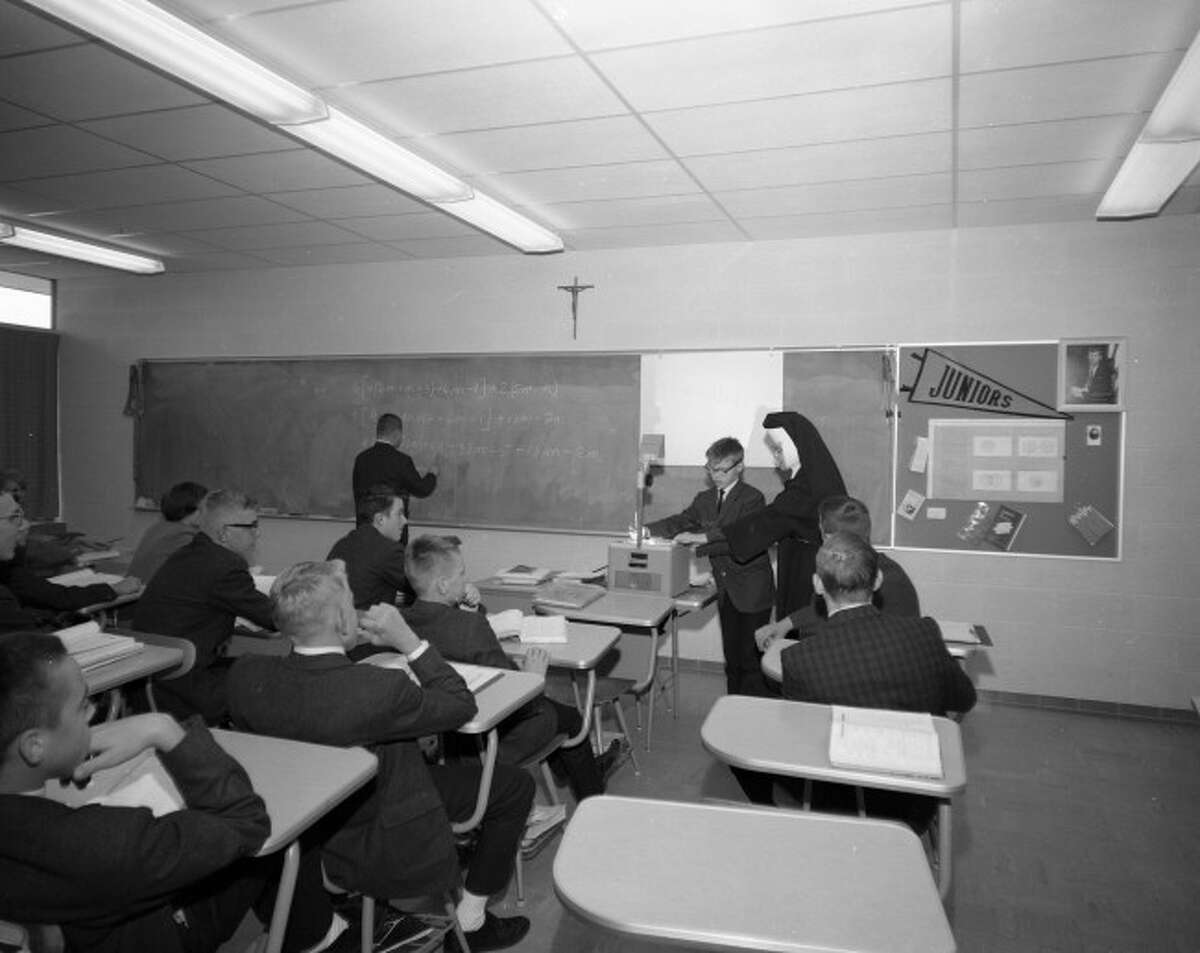Students of Manistee Catholic Central studying in a classroom in 1965.