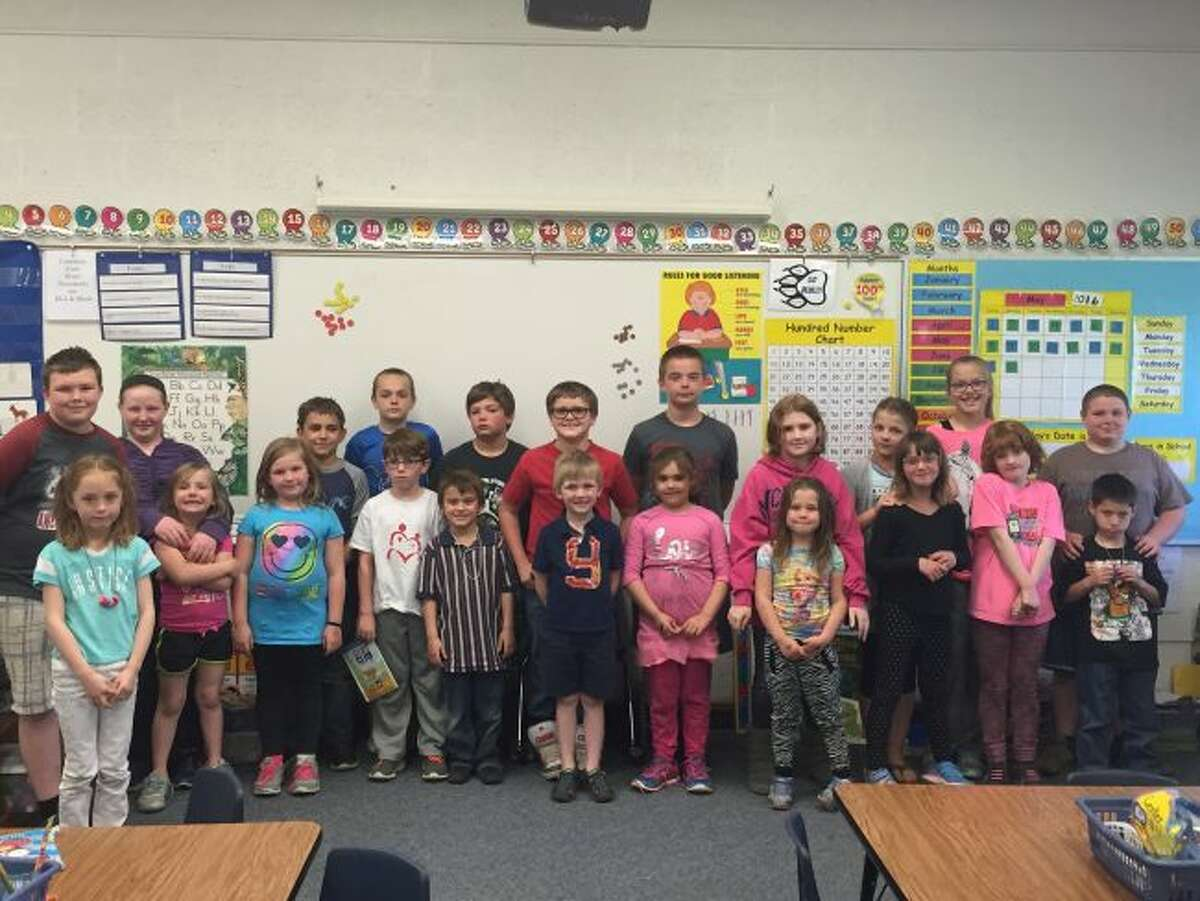 Fifth grade students of Karrie Podbilski pair up with their kindergarten/first grade buddies from Michelle McElrath's class. The two classes have been getting together all year to work on various educational projects.