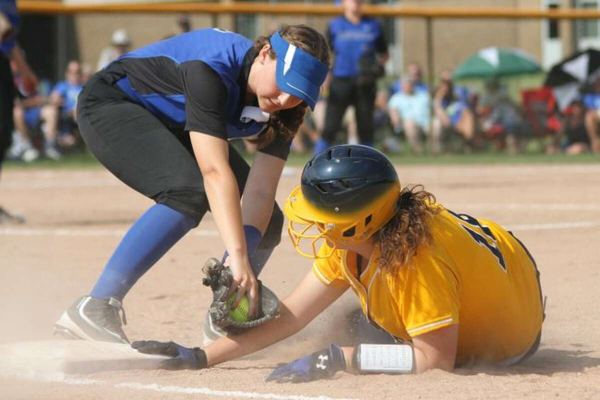 Scott Yoshonis/News AdvocateNicole Zimmerman reaches back to first base in a regional final win over Montague. The Chippewas will play Gladstone today in the quarterfinals.