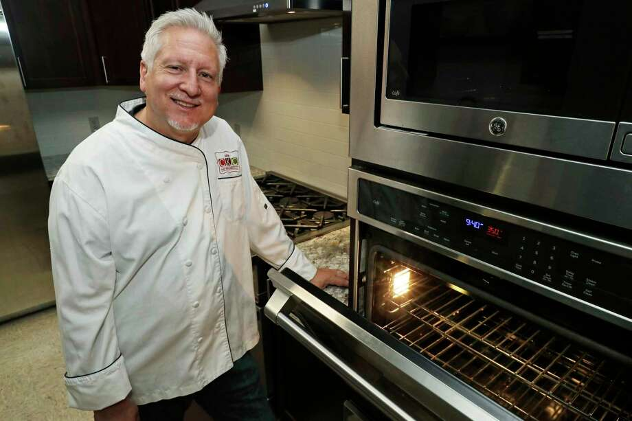 In this July 18, 2019, photo private chef Ken McNamee poses for a photo in Seattle. McNamee has cooked in exclusive clubs around the world, yet he's sometimes overwhelmed by the scale of wealth around Seattle. (AP Photo/Ted S. Warren) Photo: Ted S. Warren / Ted S. Warren/Associated Press / Copyright 2019 The Associated Press. All rights reserved.