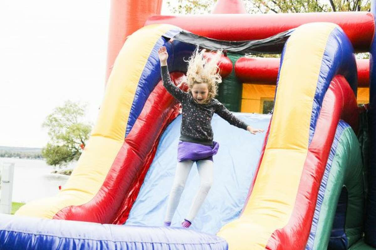 News Advocate file photoLillian Hall celebrates Bear Lake's Autumn Glory Day festival by playing in the bounce house last year in Hopkins Park. This year's event is slated for Saturday.