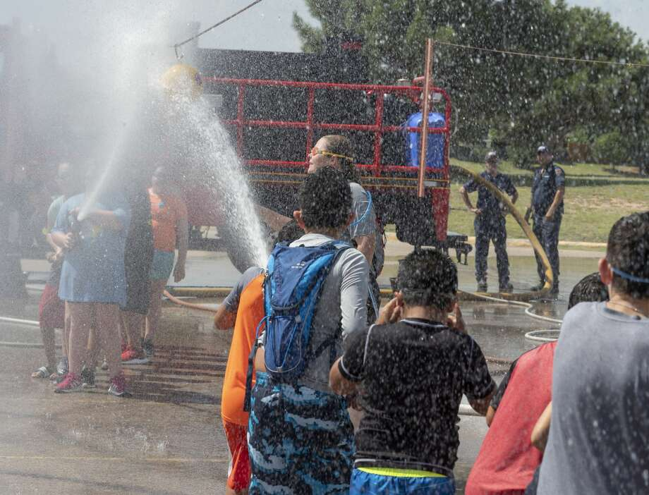 Midlanders try to beat the heat 07/30/19 at the annual Wet n' Wild with the Midland Fire Department, for the kick-off of the 2019 Wellness Tour. Tim Fischer/Reporter-Telegram Photo: Tim Fischer/Midland Reporter-Telegram