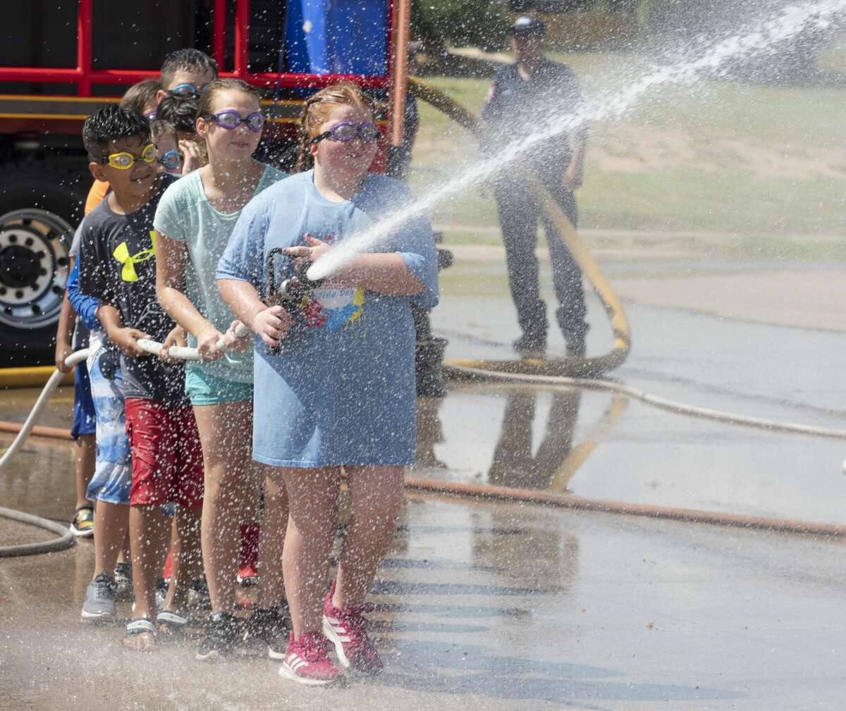 Midlanders try to beat the heat 07/30/19 at the annual Wet n' Wild with the Midland Fire Department, for the kick-off of the 2019 Wellness Tour. Tim Fischer/Reporter-Telegram