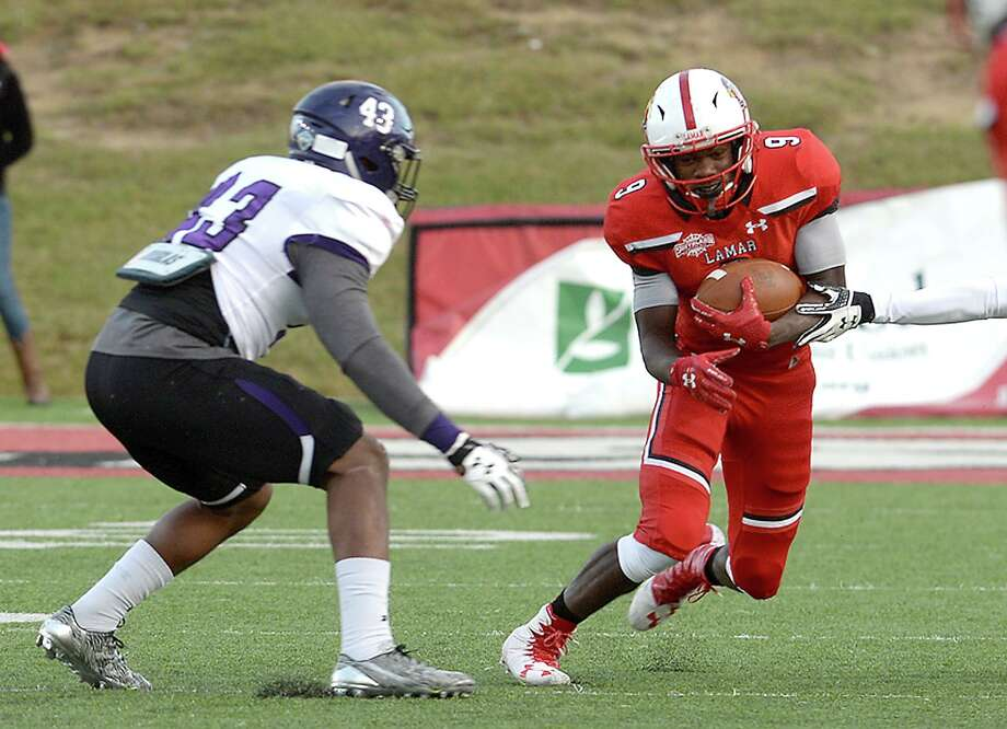 Lamar's Kendrick King looks to evade Stephen F. Austin's Anthony Jacobs as he picks up yardage during their match-up at Lamar Saturday. Photo taken Saturday, October 28, 2017 Kim Brent/The Enterprise Photo: Kim Brent / Beaumont Enterprise / BEN