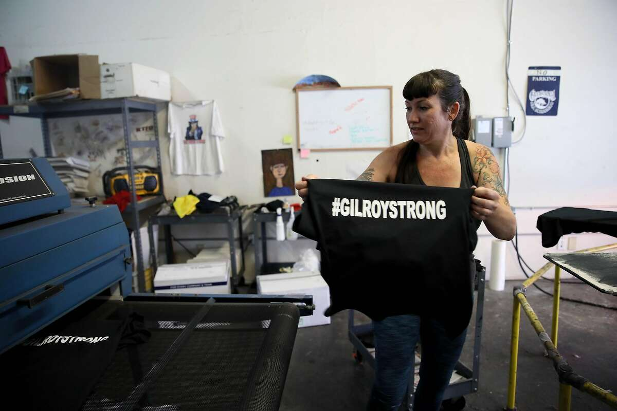 Michele Pierson, 41, co-owner of Cal Silk, makes #GilroyStrong t-shirts in Gilroy, Calif., on Tuesday, July 30, 2019.